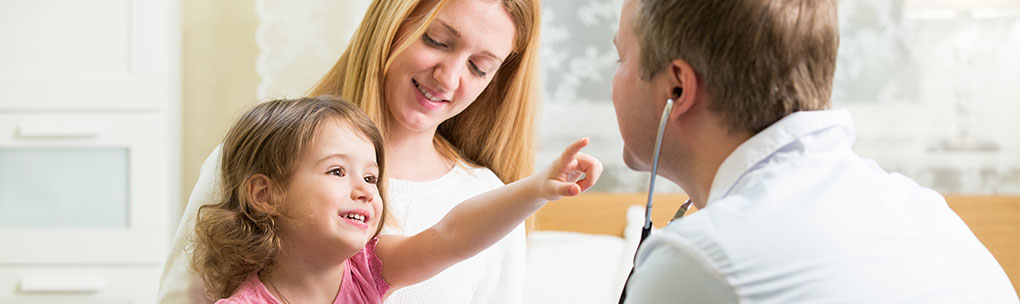Individual and Family - One Large Network - Doctor Examining Child Patient with Mother Present