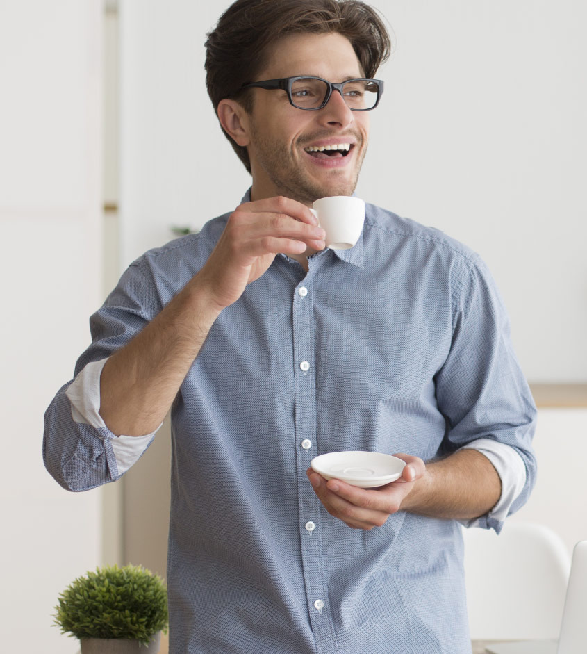 Group Benefits – Happy Man With Blue Shirt Drinking Expresso